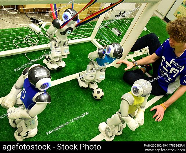 20 February 2020, Saxony, Leipzig: In the robot laboratory of the Nao-Team of the University of Applied Sciences (HTWK) student Felix Loos checks the test game...