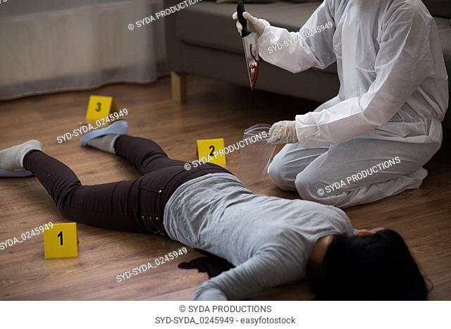 criminalist collecting crime scene evidence