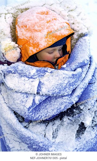 Small child covered with snow, sleeping, Sweden