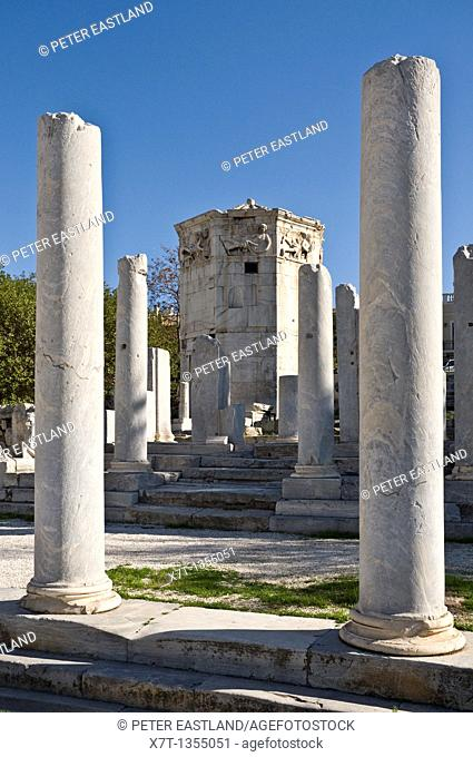 View through the columns of the Roman forum to the Tower of the winds, in the Plaka district of Athens, Greece
