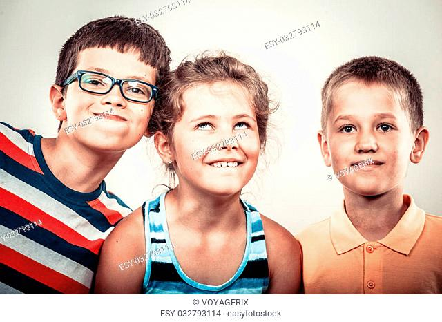 Crazy kids little girl and boys making silly face expression. Childhood fun