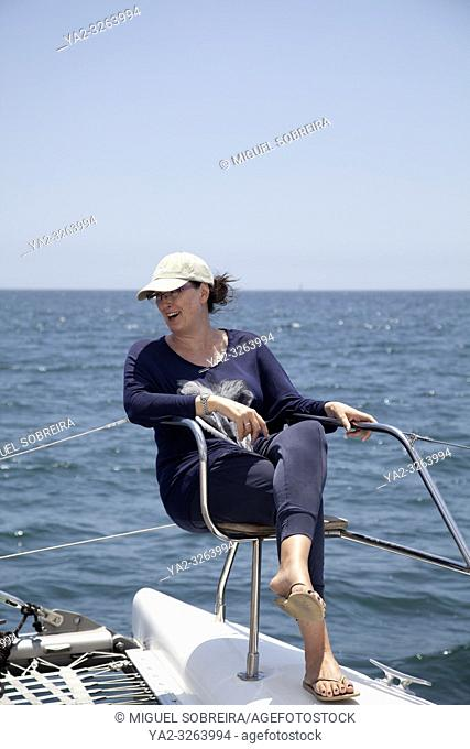 Woman On Deck Seat on Catamaran at Sea in Table Bay, Cape Town, South Africa