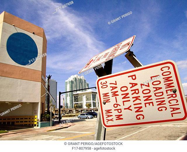 a broken street sign after hurricane