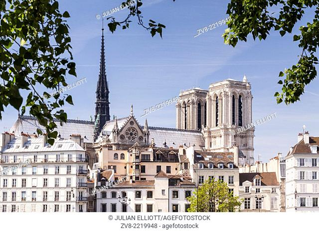 Notre Dame cathedral rising above Ile de la Cite. The cathedral is widely considered to be one of the finest examples of French Gothic architecture and among...