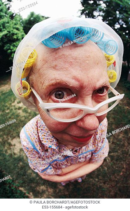 Senior woman with eyeglasses and hair in curlers