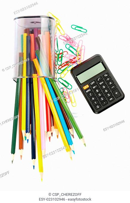 Fallen pencil cup with crayons and calculator