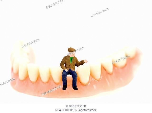 symbolic, senior figure on fals teeth