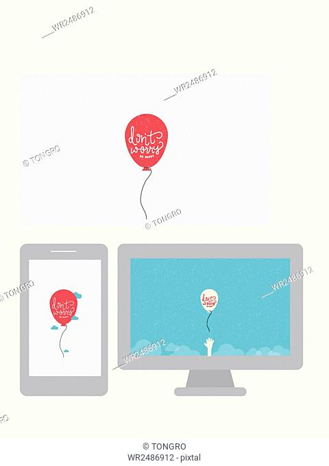 Balloons with message of Don't Worry on tablet, smartphone and monitor