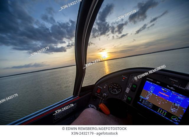 Instrument of seaplane while flying above water at sunset in Southeastern USA
