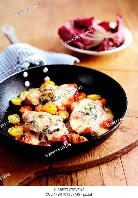 Pan of chicken and tomatoes
