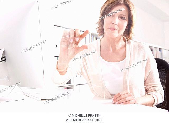Woman using transparent touchscreen display