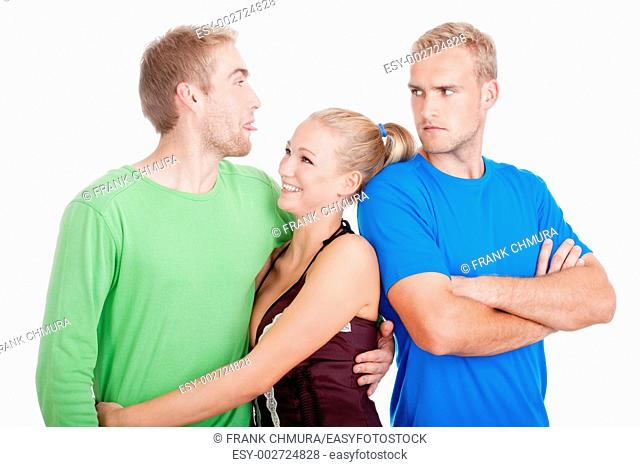 man with a girlfriend sticking out tongue to his jealaus brother - isolated on white