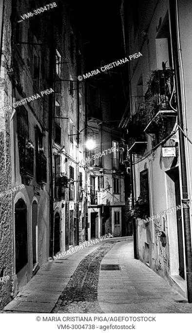 a narrow cobbled street in the ancient quarter of Castello in Cagliaria, Sardinia Italy