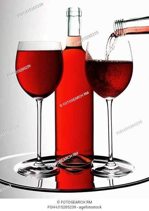 Two Glasses of Rose Blush Wine With Bottle - Non Exclusive