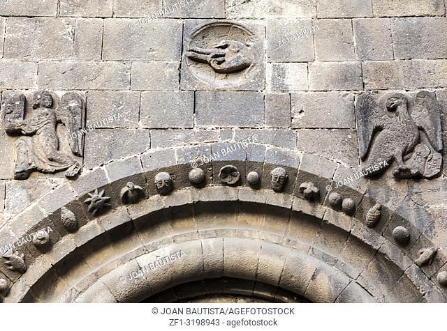 Ancient medieval symbols in door entrance of monastery benedictine of Sant Pau del Camp, romanesque style in El Raval quarter of Barcelona. Spain