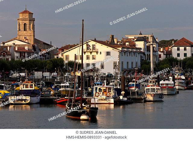 France, Pyrenees Atlantiques, Basque Country, Saint Jean de Luz, Evening light on the fishing port and the church of Saint Jean Baptiste