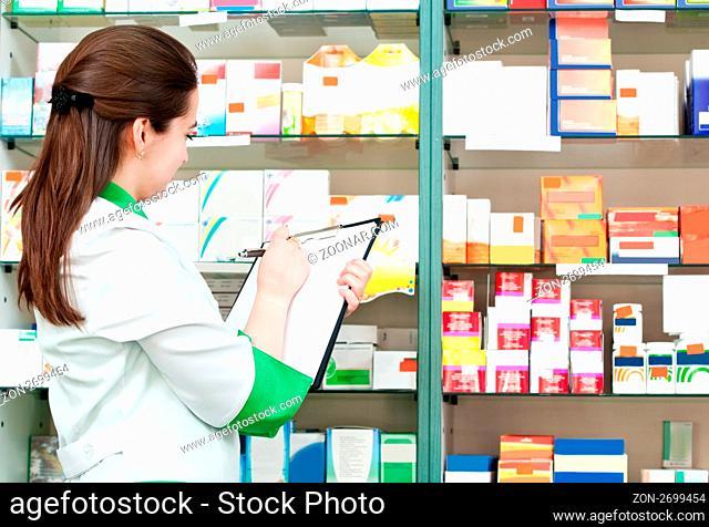 pharmacist chemist woman working in pharmacy drugstore