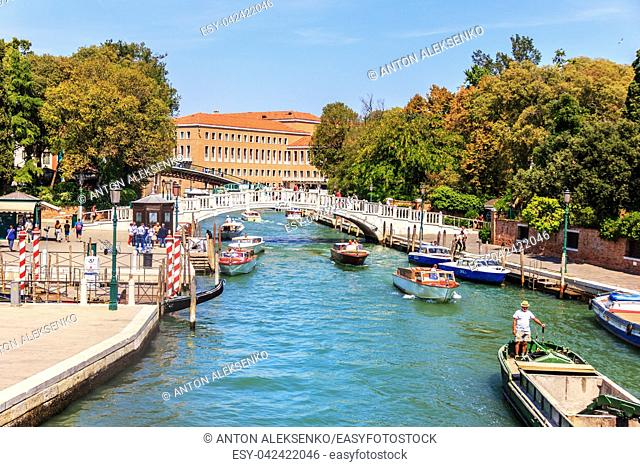 Venice, Italy - 22 August, 2018: Papadopoli Bridge over a channel, view on the wharf