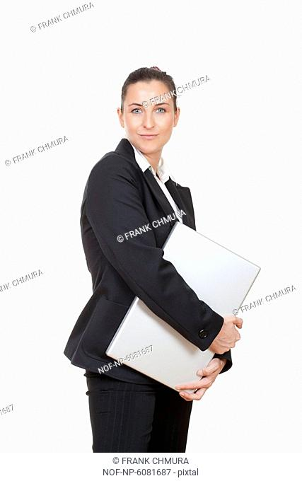 Attractive businesswoman with laptop computer smiling