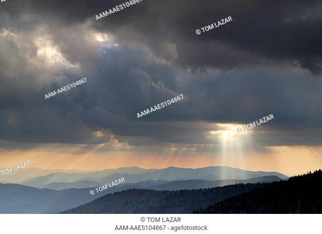 Smokey Mountains National Park; Tennessee; Clingmans Dome; Light beams streaming through sky from behind dark Cumulus clouds above rolling, layered mountains