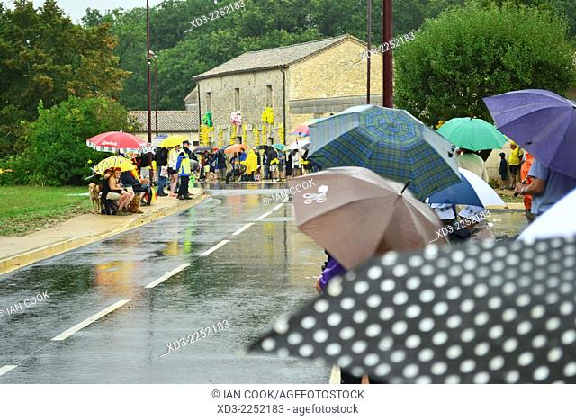 waiting in the rain for the 2014 Tour de France Stage 19 at Monbazillac, Dordogne Department, Aquitaine, France
