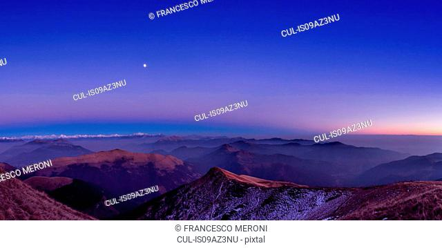 Elevated panoramic mountain landscape with valley mist at dawn, Monte Generoso,Ticino, Switzerland