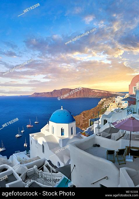 Sunset over the traditional Greek Orthodox churches of Oia (ia), Cyclades Island of Thira, Santorini, Greece. . . The settlement of Oia had been mentioned in...