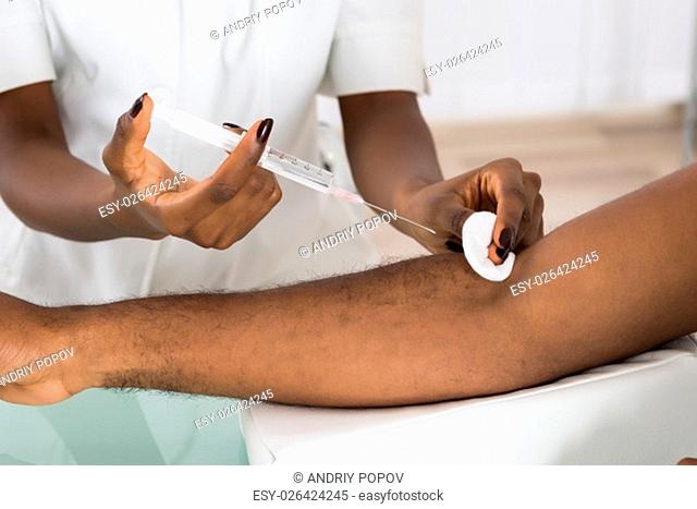 Close-up Doctor's Hand Giving Vaccination For Patient