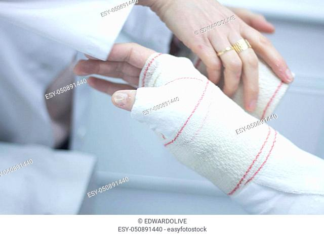 Nurse bandages patient hand wrist Stock Photos and Images