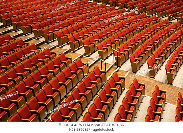 Rows of red seats in the Queen Elizabeth Theatre, Vancouver, BC, Canada