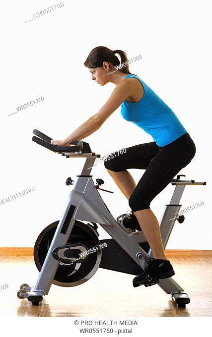young woman at a treadmill in a fitness center