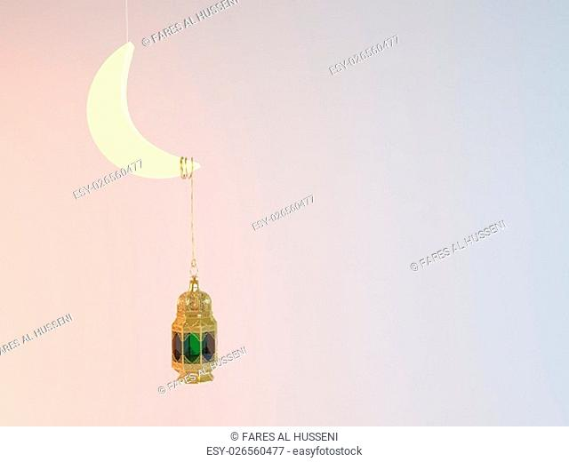 3d rendering Ramadan Kareem 3d illustration with a moon and a lantern attached to it
