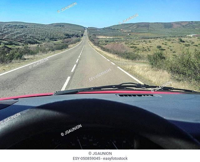 Driving along Granadilla Region, Extremadura, Spain. Speeding up straightaway