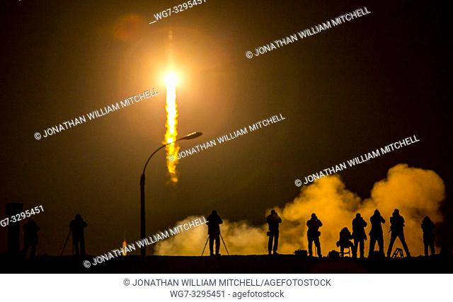 KAZAKHSTAN Baikonur Cosmodrome -- 28 Mar 2015 -- Media photograph the Soyuz TMA-16M spacecraft is seen as it launches to the International Space Station with...