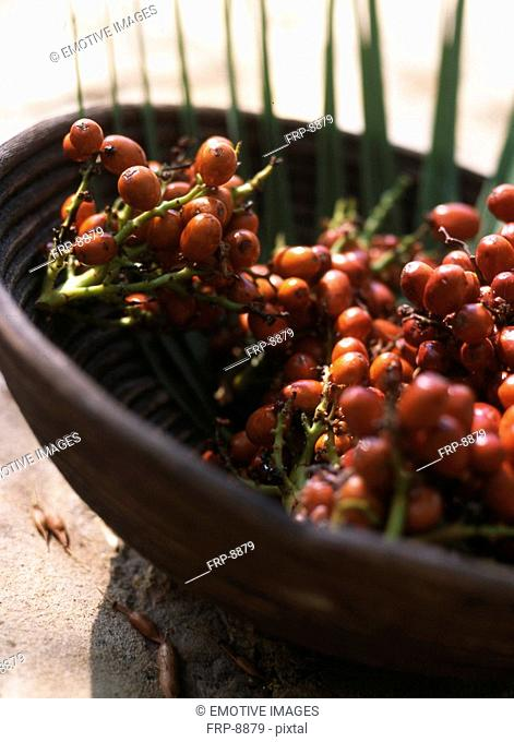 Palm tree fruits in a bowl