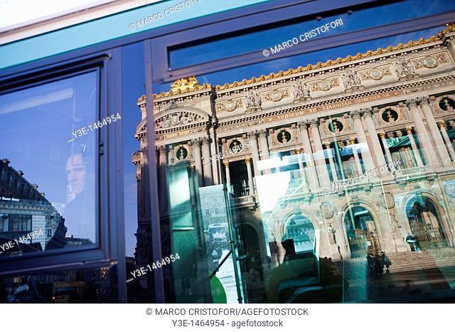 Opera Garnier building reflecting in a window bus Paris France