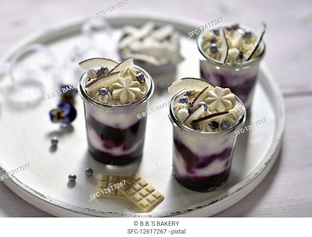 Vegan coconut and blueberry cheesecakes in glasses