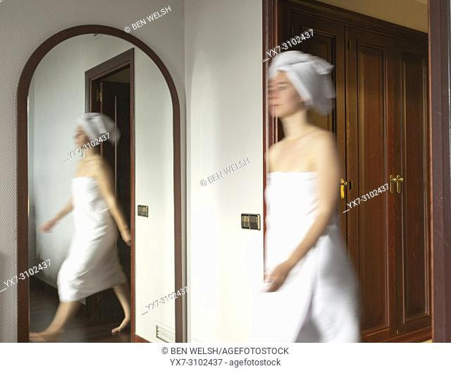 Young woman in a hotel room. Madrid, Spain, Europe