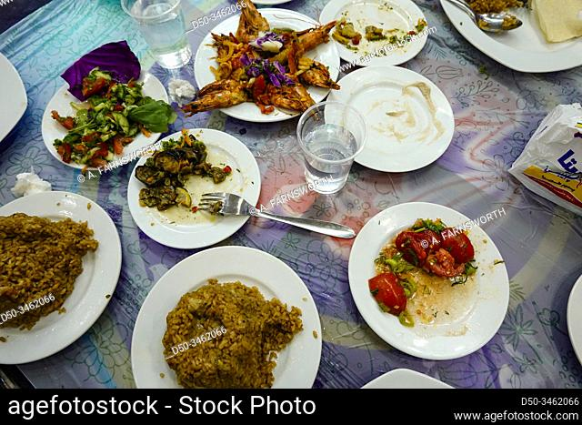 Marsa Matruh, Egypt An assortment of dishes at a local fish restaurant including grilled shrimp, rice, eggplant, salads