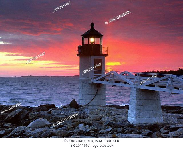 Spectacular sunset behind Marshall Point Lighthouse in Port Clyde, Maine, USA