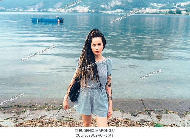 Woman by lakeside, Como, Lombardia, Italy