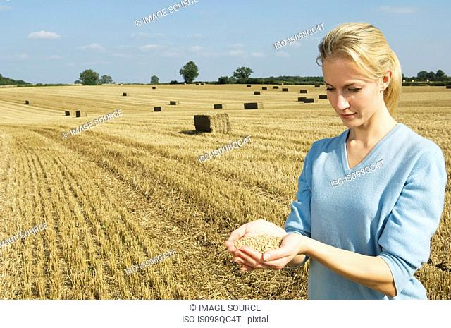Woman holding grains of wheat