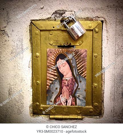 A moneybox closed with a lock decorated with an image of Our Lady of Guadalupe in Colonia Roma, Mexico City, Mexico