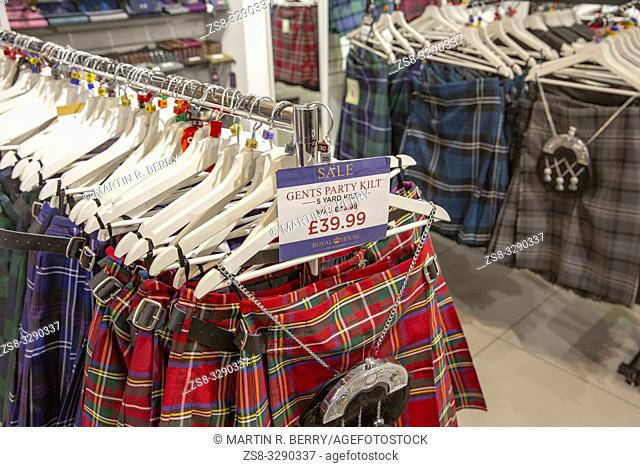 Mens party tartan kilts on sale in a store in Edinburgh, Scotland