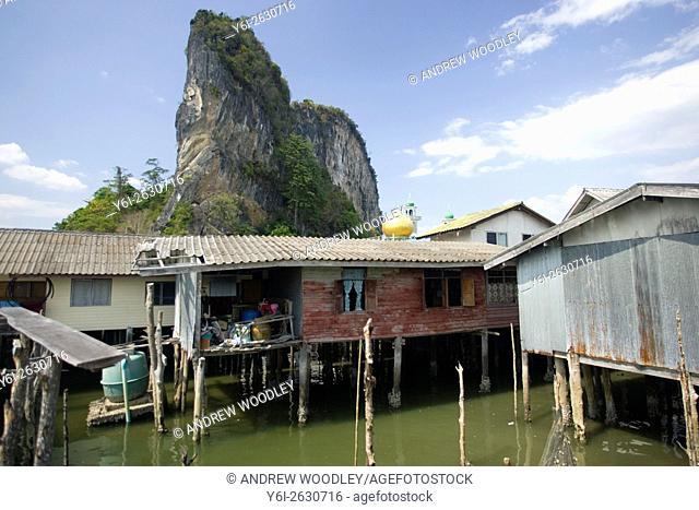 A gold dome tops the mosque Ko Panyi Muslim fishing village on stilts Phang Nga Bay Thailand