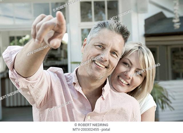 Man woman middle aged pointing garden loving happy