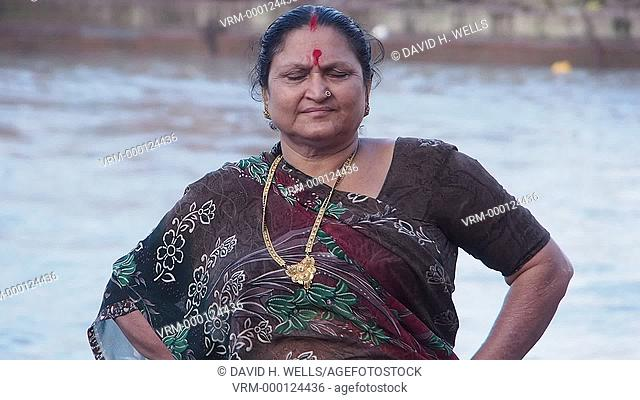 Portrait of a mature woman in front of river ganges at Haridwar, Uttarakhand, India