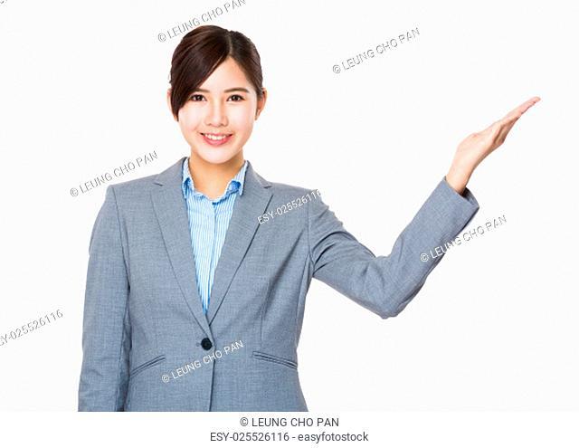 Businesswoman with hand presentation