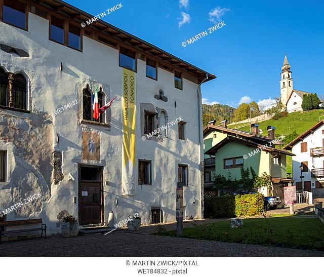 Palazzo Scopoli und Chiesa San Vittore. Traditional architecture of the Primiero. Tonadico in the valley of Primiero in the Dolomites of Trentino