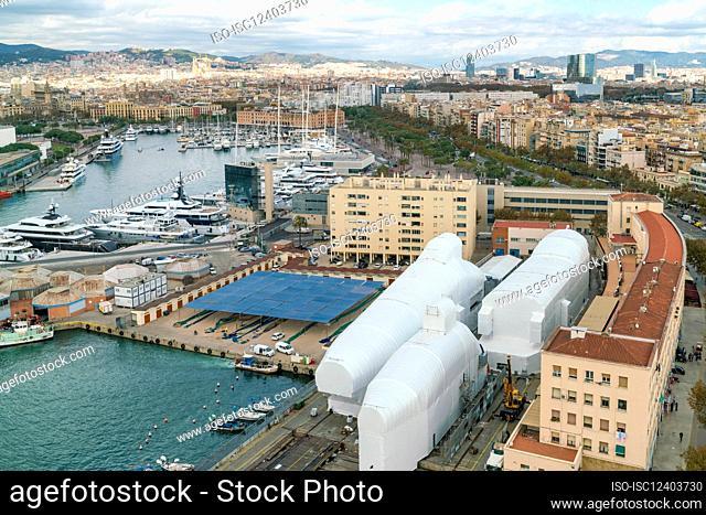 Spain, Barcelona, Harbor and cityscape